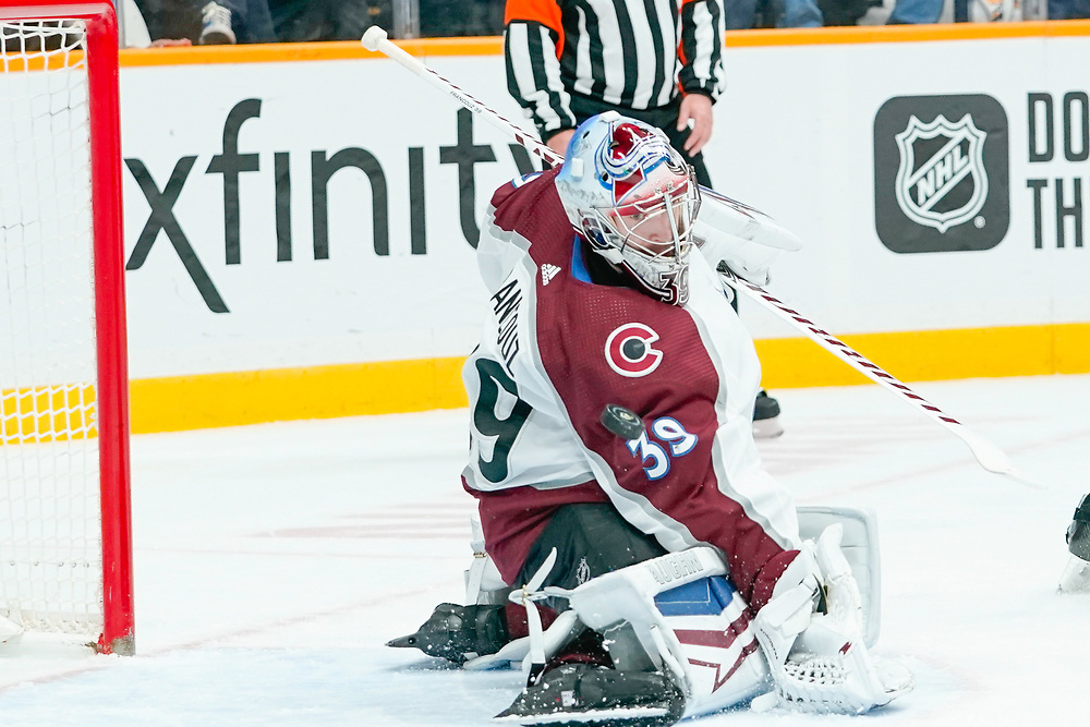 Colorado Avalanche  goaltender Pavel Francouz (39) watches as the puck flys into the goal during an NHL game between the Colorado Avalanche and Nashville Predators at Bridgestone Arena in Nashville, TN
