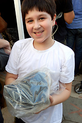 People wait to receive gas-masks in Tel Aviv. <br /> A youngster with his old gas-mask out of its box but in its plastic bag, queues to get a replacement in a suburb of Tel Aviv as tension mounts over allied military strikes in Syria and Iran threatens Israel if Syria is hit, <br /> Tel Aviv, Israel.<br /> Friday, 30th August 2013. Picture by Max Nash / i-Images