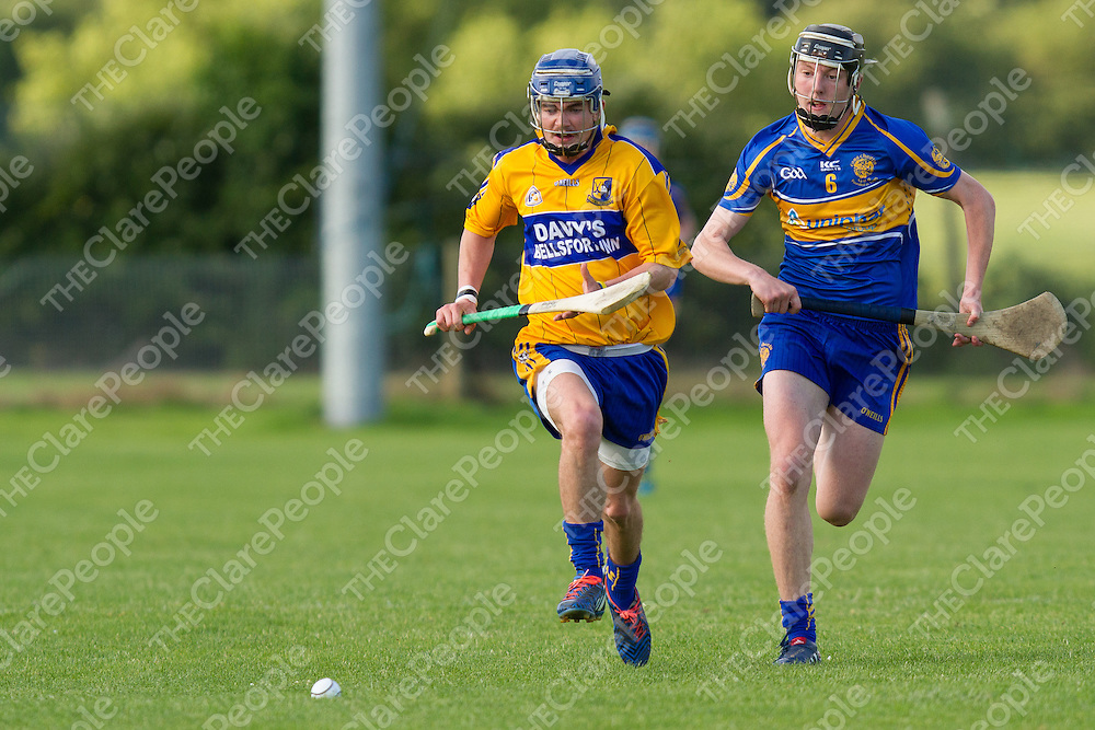 Sixmilebridge Colm Fitzgerald and Newmarket-on-Fergus's Liam O'Connor both keep their eye on the slíotar