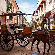 "VIGAN (Philippines). 2009. ""Kalesa"" in Mestizo District,  Vigan, Ilocos Sur. Vigan is considered the finest surviving example of a spanish colonial town in Asia."
