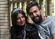 Iran, Tehran Province, Tehran, smiling Iranian couple.
