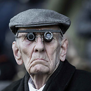 An elderly Pollok fan watches the action at the Pollok v Hurlford Utd juniors match at Newlandsfield, Glasgow.<br /> <br /> Picture Robert Perry 18th Jan 2020<br /> <br /> Must credit photo to Robert Perry<br /> FEE PAYABLE FOR REPRO USE<br /> FEE PAYABLE FOR ALL INTERNET USE<br /> www.robertperry.co.uk<br /> NB -This image is not to be distributed without the prior consent of the copyright holder.<br /> in using this image you agree to abide by terms and conditions as stated in this caption.<br /> All monies payable to Robert Perry<br /> <br /> (PLEASE DO NOT REMOVE THIS CAPTION)<br /> This image is intended for Editorial use (e.g. news). Any commercial or promotional use requires additional clearance. <br /> Copyright 2018 All rights protected.<br /> first use only<br /> contact details<br /> Robert Perry     <br /> <br /> no internet usage without prior consent.         <br /> Robert Perry reserves the right to pursue unauthorised use of this image . If you violate my intellectual property you may be liable for  damages, loss of income, and profits you derive from the use of this image.