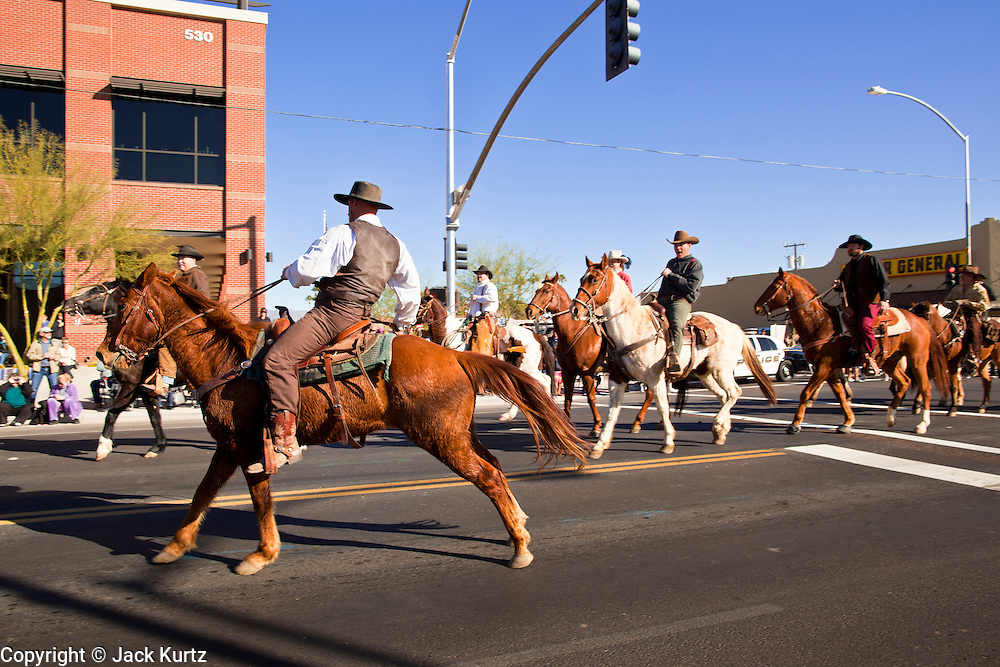 28 JANUARY 2012 - BUCKEYE, AZ:    The JayCees Commancheros ride in the Buckeye Days parade. The Buckeye Days parade went through downtown Buckeye, AZ, an agricultural community about 45 miles west of Phoenix. The parade was one the first events to mark Arizona's centennial celebration. Arizona was admitted to the United States on Feb 14, 1912, making it the 48th state in the union. The state celebrates its 100th birthday with a series of events on Feb. 14, 2012.    PHOTO BY JACK KURTZ