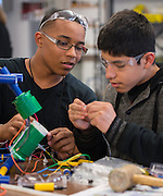 Students from the Energy Institute High School build an aquatic remote operated vehicle during a workshop sponsored by the Marine Advanced Technology Education (MATE) Center held at Waltrip High School, February 1, 2014.