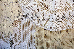 Europe, Croatia, Dalmatia, Dubrovnik.  Traditional lace displayed for sale.  The historic center of Dubrovnik is a UNESCO World Heritage site.
