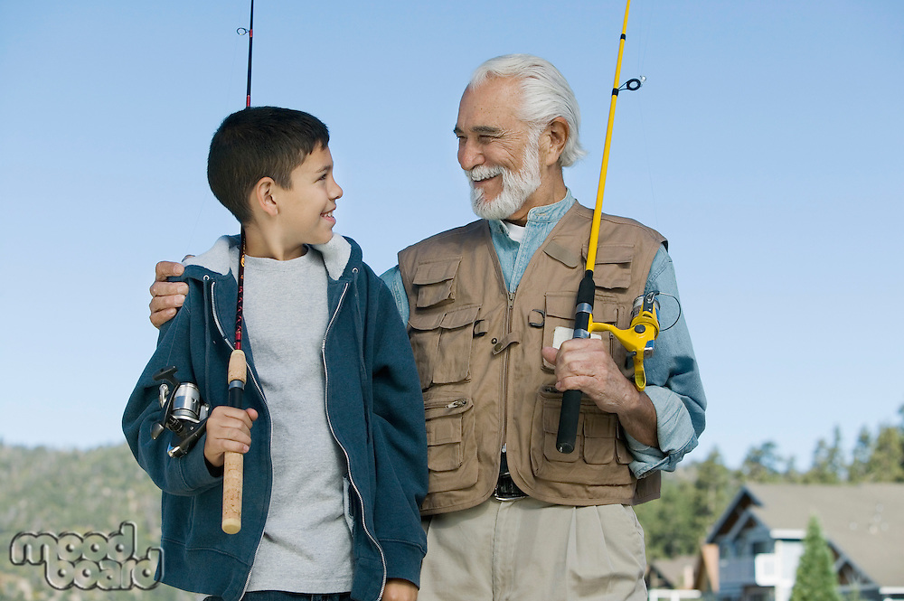Grandfather and Grandson Enjoying Fishing Together