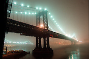 Fog over the East River looking at the Manhattan bridge from Dumbo, Brooklyn, NY, USA. circa 1998