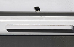 © Licensed to London News Pictures. 04/04/2018. London, UK. A bullet hole in a window frame at a property on Chalgrove Road in Tottenham, north London where 17 year old Tanesha Melbourne was shot dead. A recent spree of killings in the capital has taken the murder toll for the year so far to 48. Photo credit: Ben Cawthra/LNP