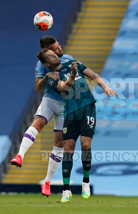 Nicolas Otamendi of Manchester City challenges Jay Rodriguez of Burnleyduring the Premier League match at the Etihad Stadium, Manchester. Picture date: 22nd February 2020. Picture credit should read: Andrew Yates/Sportimage