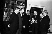 """21/5/1965<br /> 5/21/1965<br /> 21/5/1965<br /> <br /> President de Valera recived an inscribed mathematic textbook """"Matamatic na h'ard Teistimeireachta"""" from the author An Br. Tomás Ó Catnain, Mount Sion Waterford.<br /> <br /> Mr. Kevin Boland T.D.; Mr. George Colley T.D.; President de Valera; An BR Ó Catháin;Mr Charles Haughey T.D. and An Tadh Ó Mhuimhneacháin Provincial. St. Booterstown"""