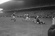 Kerry's P.O'Donoghue on the ground and Down's S. O'Neill have a collision while attempting to get the ball during the All Ireland Senior Gaelic Football Final Kerry v Down in Croke Park on the 22nd September 1968. Down 2-12 Kerry 1-13.