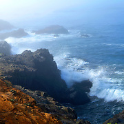 Northern california coast line. Ocean waves crash on shore.