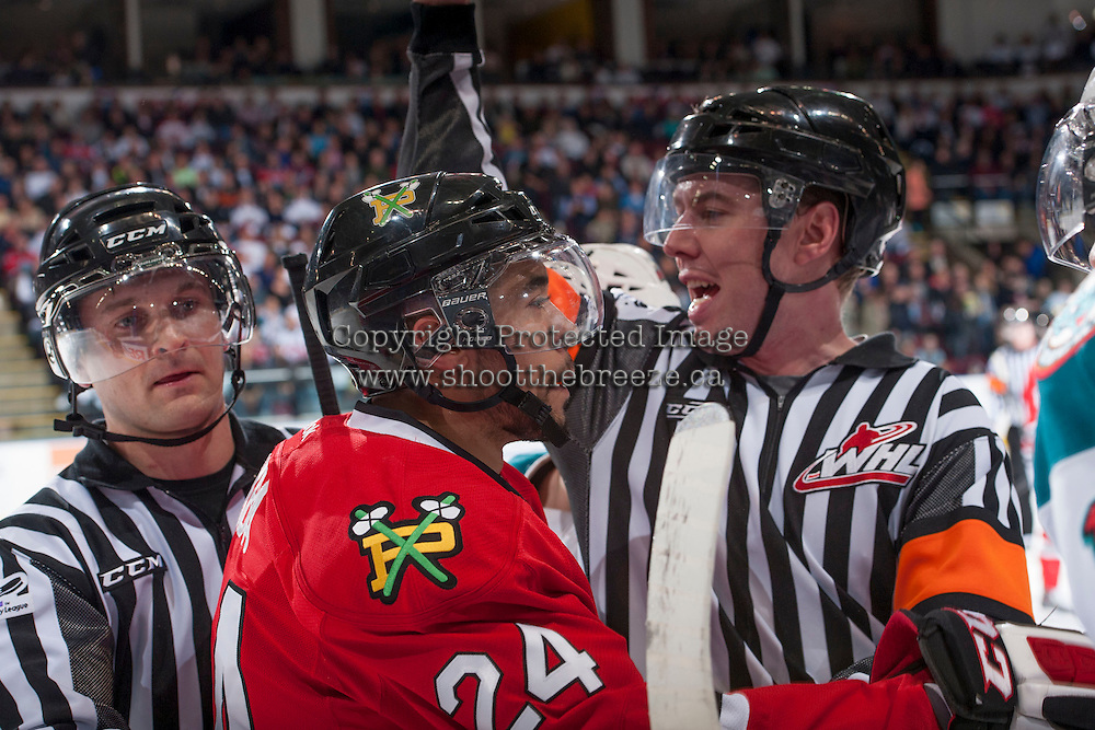 KELOWNA, CANADA - APRIL 19: Mathew Dumba #24 of the Portland Winterhawks trash talks the # of the Kelowna Rockets' bench on April 18, 2014 during Game 2 of the third round of WHL Playoffs at Prospera Place in Kelowna, British Columbia, Canada.   (Photo by Marissa Baecker/Shoot the Breeze)  *** Local Caption *** Mathew Dumba;
