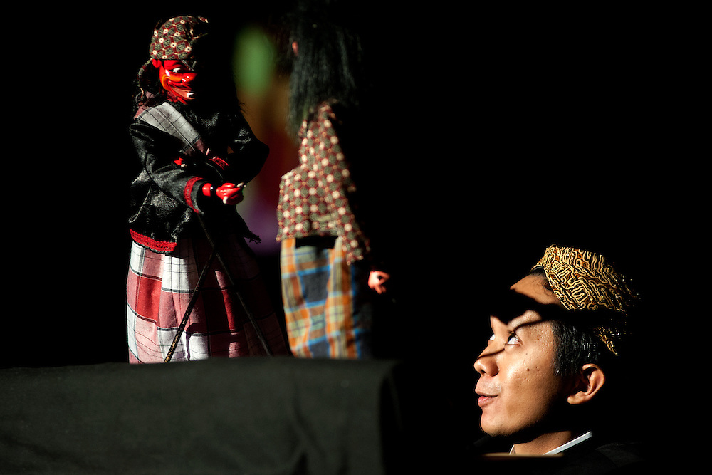 Puppeteer Anton Sutandio entertains guest at Ohio University Indonesian Night with a performance of traditional puppetry. Photo by: Ross Brinkerhoff.