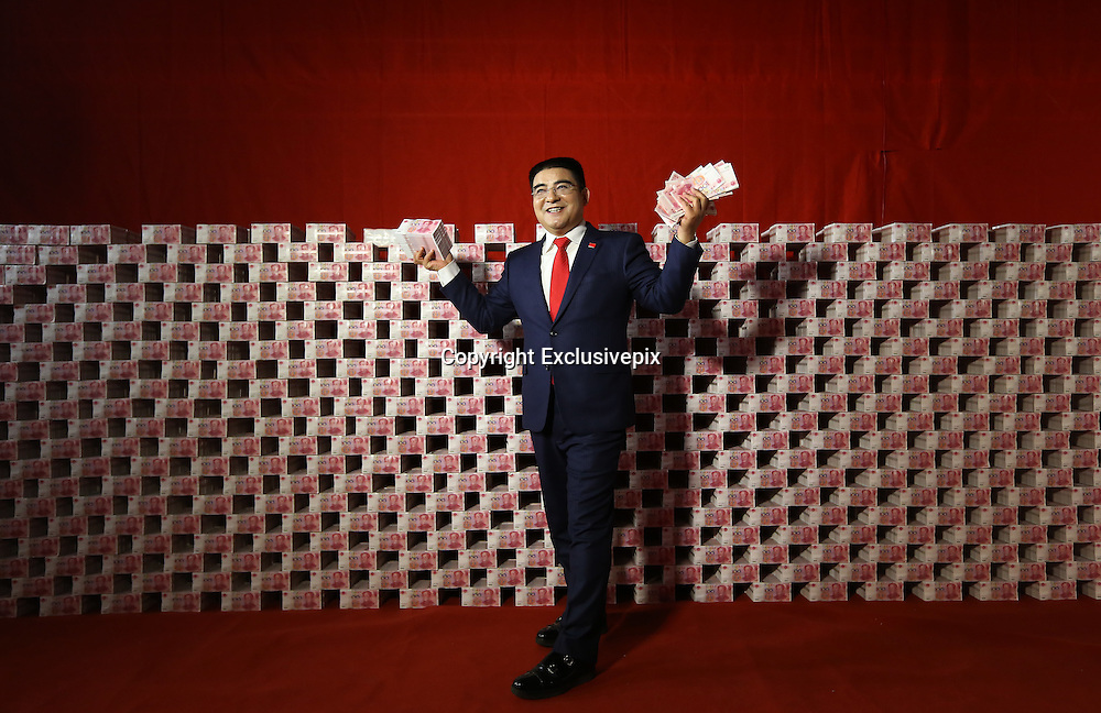 """NANJING, CHINA - DECEMBER 24:  China Out - Finland Out<br /> <br /> A Billionaire And His """"Money Wall"""" <br /> <br /> Chinese billionaire and philanthropist Chen Guangbiao, Chairman of Jiangsu Huangpu Recycling Resources Co., Ltd, poses at a temporary television studio decorated with 16 tons of 100-yuan bank notes to promote the upcoming national economic census on December 24, 2013 in Nanjing, Jiangsu province of China. The cash was transported to the studio in a large truck and it took 20 people five hours to decorate the tent-turned-TV-studio with the cash. Chen has used money as a background for his charitable promotions since 2010. """"This is the sixth time for me to use money as background,"""" he said, """"The amount of money is the largest this time and it will also be the last time.""""<br /> ©Exclusivepix"""