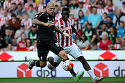 Martin Skrtel and Mame Biram Diouf battle for the ball during the Barclays Premier League match between Stoke City and Liverpool at the Britannia Stadium, Stoke-on-Trent, England on 9 August 2015. Photo by Alan Franklin.