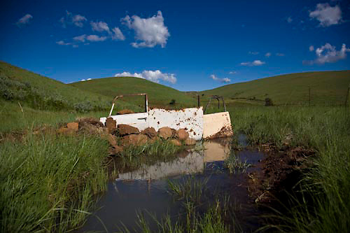 Old car doors (one of them is a 404 Peugeot) and panels direct a stream for a farmer hear Mthulastand, Mpumlanaga, Dec 2008. Photo Mpho Khwezi.