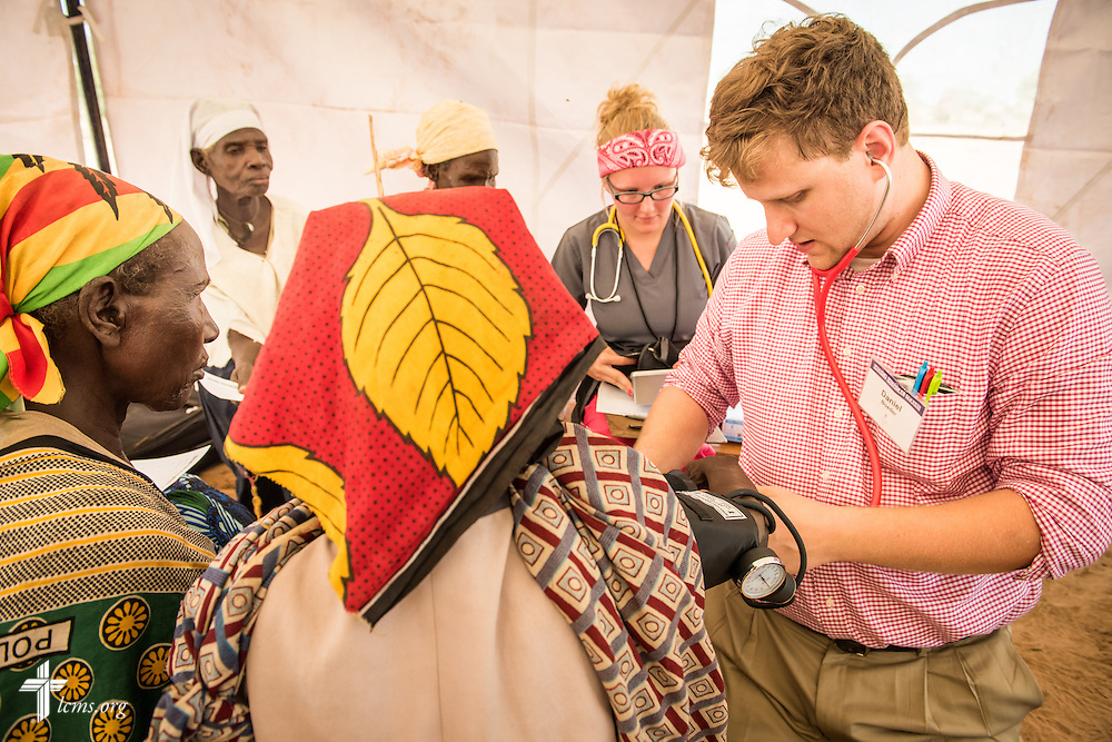 Daniel Boeder, a second-year medical student and a member of Trinity Lutheran Church, Springfield, Ill. works with patients at the LCMS Mercy Medical Team clinic on Monday, June 20, 2016, in Nataparkakono, a village in Turkana, Kenya.  LCMS Communications/Erik M. Lunsford
