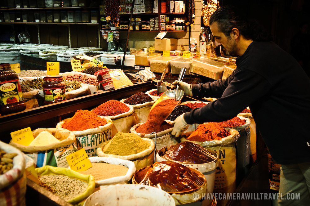 A spice merchant tops up his display of assorted spices for sale next to the Spice Bazaar (also known as the Egyption Bazaar) in Istanbul, Turkey.