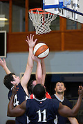 UK - Tuesday, Nov 18 2008:  Surrounded by Sledgehammer players, Erks' Declan McCusker gets off a score during the Barking and Dagenham Erkenwald Basketball Club's Essex Basketball League game against Brightlingsea Sledgehammers. Erks won the game 91 - 86. (Photo by Peter Horrell / http://www.peterhorrell.com)