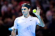 Roger Federer holds the ball up to show it to Andy Murray during the Andy Murray Live event at SSE Hydro, Glasgow, Scotland on 7 November 2017. Photo by Craig Doyle.
