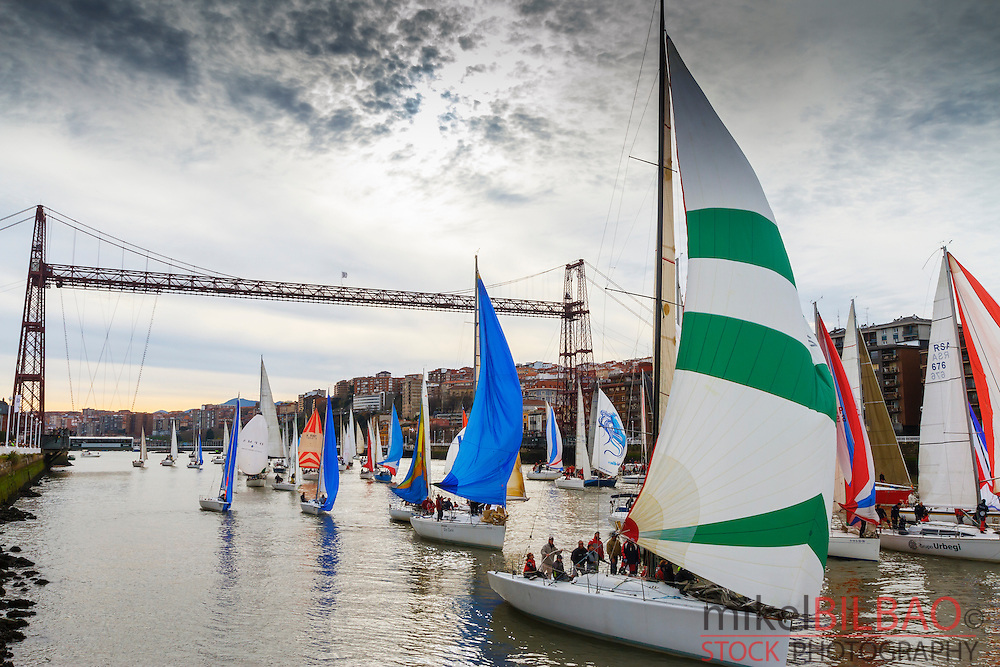 Gallo boat race and Vizcaya bridge. Mouth of Nervion river. Portugalete, Biscay, Basque Country, Spain, Europe.
