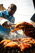 Dovonan Murphy owner of Island Quizine grilling jerk chicken