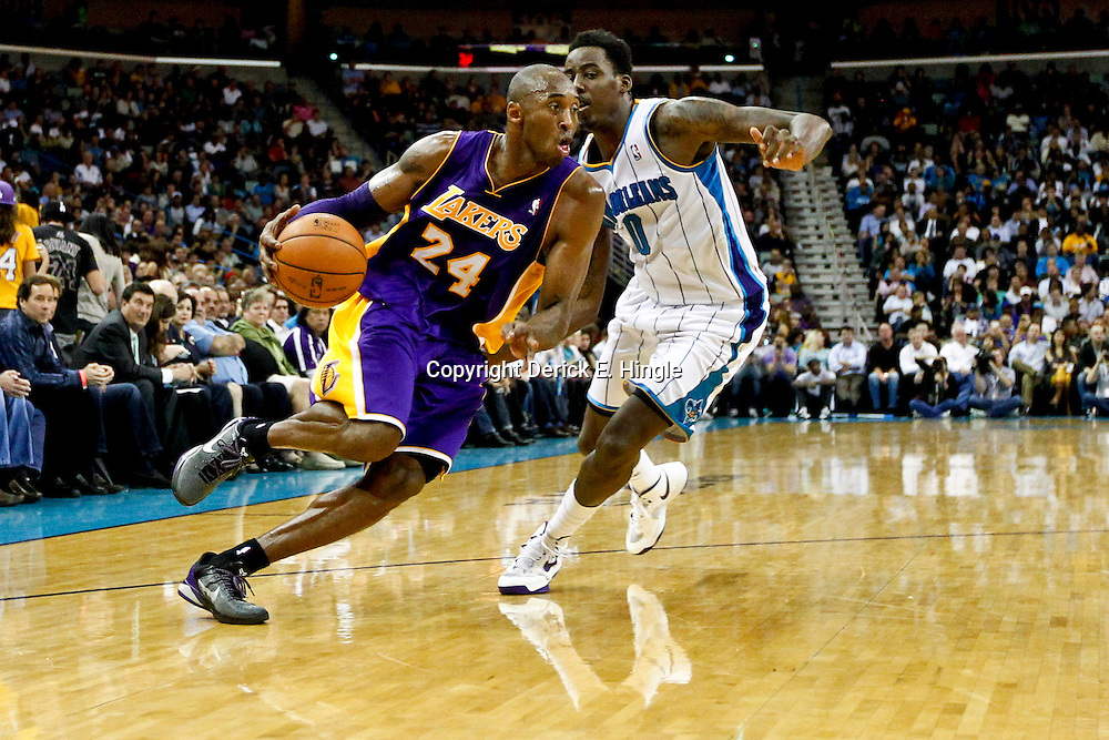 Dec 5, 2012; New Orleans, LA, USA; Los Angeles Lakers shooting guard Kobe Bryant (24) drives past New Orleans Hornets small forward Al-Farouq Aminu (0) during the second quarter of a game at the New Orleans Arena.  Mandatory Credit: Derick E. Hingle-USA TODAY Sports