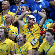 Swimming - Olympics: Day 1 The Australian swim team cheer  Mack Horton, Australia, winning the gold medal in the Men's 400m Freestyle Final during the swimming competition at the Olympic Aquatics Stadium August 6, 2016 in Rio de Janeiro, Brazil. (Photo by Tim Clayton/Corbis via Getty Images)