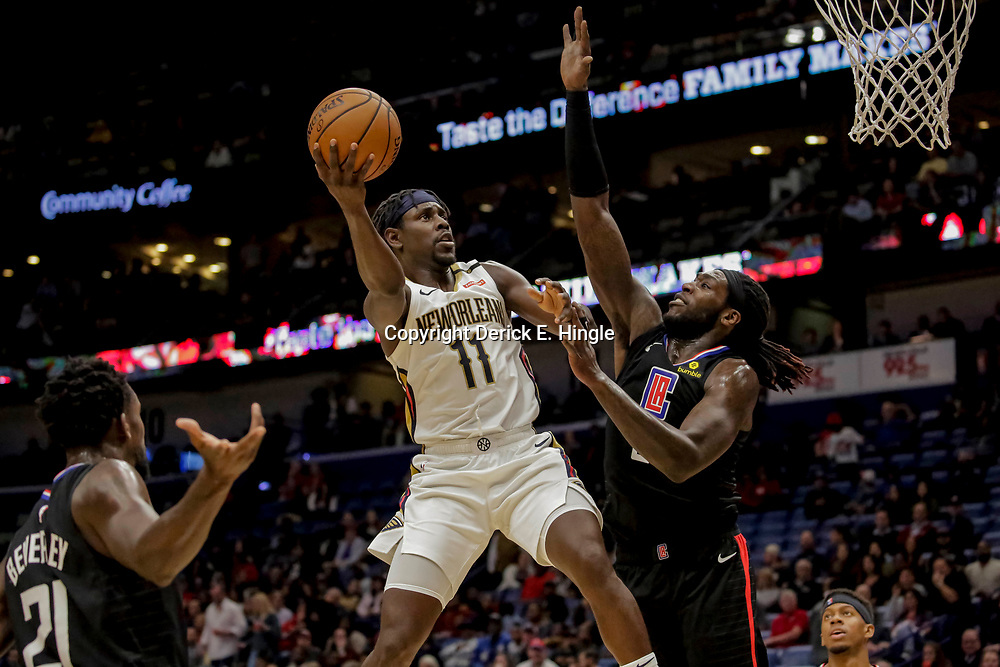 Dec 3, 2018; New Orleans, LA, USA; New Orleans Pelicans guard Jrue Holiday (11) shoots over LA Clippers forward Montrezl Harrell (5) during the second half at the Smoothie King Center. Mandatory Credit: Derick E. Hingle-USA TODAY Sports