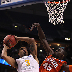 Mar 17, 2011; Tampa, FL, USA; West Virginia Mountaineers guard Casey Mitchell (3) shoots over Clemson Tigers forward/center Jerai Grant (45) during the second half of the second round of the 2011 NCAA men's basketball tournament at the St. Pete Times Forum. West Virginia defeated Clemson 84-76.  Mandatory Credit: Derick E. Hingle