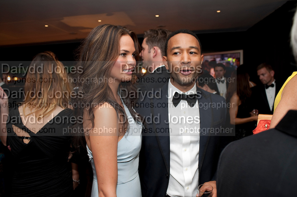 Chrissy Teigen; John Legend, GQ Man of the Year awards. The royal Opera House. Covent Garden. London. 6 September 2011. <br /> <br />  , -DO NOT ARCHIVE-© Copyright Photograph by Dafydd Jones. 248 Clapham Rd. London SW9 0PZ. Tel 0207 820 0771. www.dafjones.com.