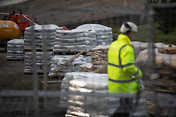 © Licensed to London News Pictures. 03/08/2019. Whaley Bridge, UK. Bags of cement are seen stacked up by the side of the reservoir . The town of Whaley Bridge in Derbyshire remains evacuated after heavy rain caused damage to the Toddbrook Reservoir , threatening homes and businesses with flooding. Photo credit: Joel Goodman/LNP