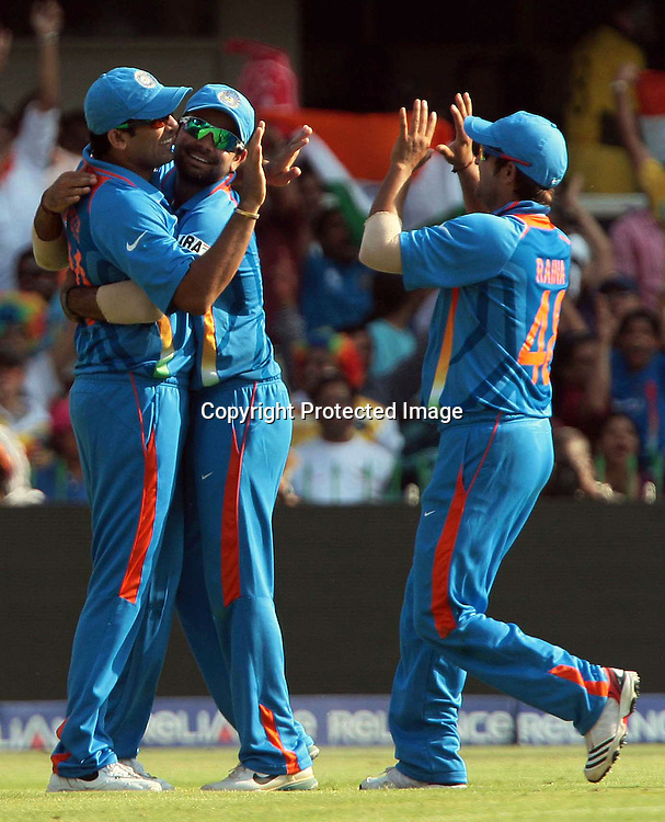 Indian player Zaheer Khan celebrates with Virat Kohli and Suresh Raina after taken <br /> Australia batsman Michael Clarke catch during the 2nd Quarter final India vs Australia on 24th March 2011, at Motara Cricket Stadium in Ahemdabad,
