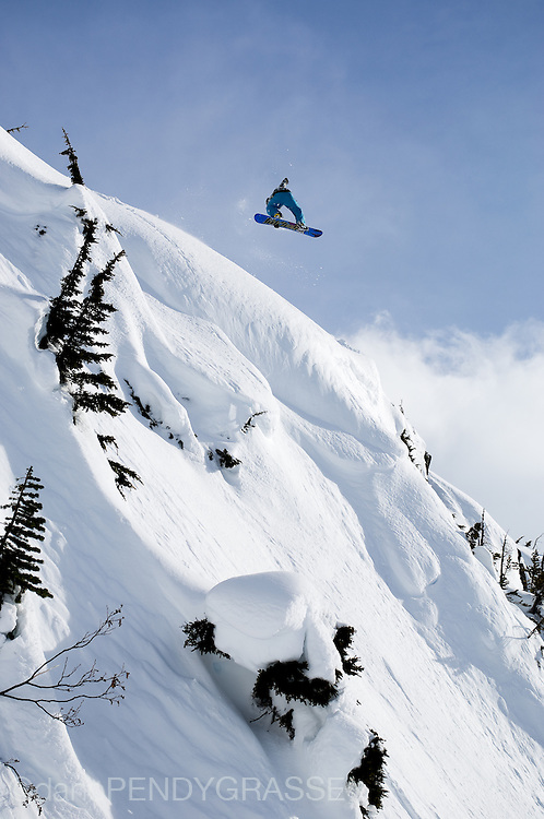 Pro snowboarder Mark Landvik spins through the air while riding near Terrace, BC.