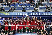Portugal players celebrate and lift the Euro 2016 trophy during the Euro 2016 final between Portugal and France at Stade de France, Saint-Denis, Paris, France on 10 July 2016. Photo by Phil Duncan.