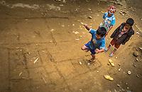 SAPA, VIETNAM - CIRCA SEPTEMBER 2014:  Kids playing hopscotch in Ta Phin Village near Sapa, north Vietnam.