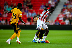 Elliot Watt of Wolverhampton Wanderers tackles Mame Biram Diouf of Stoke City - Mandatory by-line: Robbie Stephenson/JMP - 25/07/2018 - FOOTBALL - Bet365 Stadium - Stoke-on-Trent, England - Stoke City v Wolverhampton Wanderers - Pre-season friendly