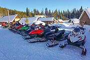 Group of snowmobilies in winter at Burgdorf Hot Springs near McCall, Idaho.