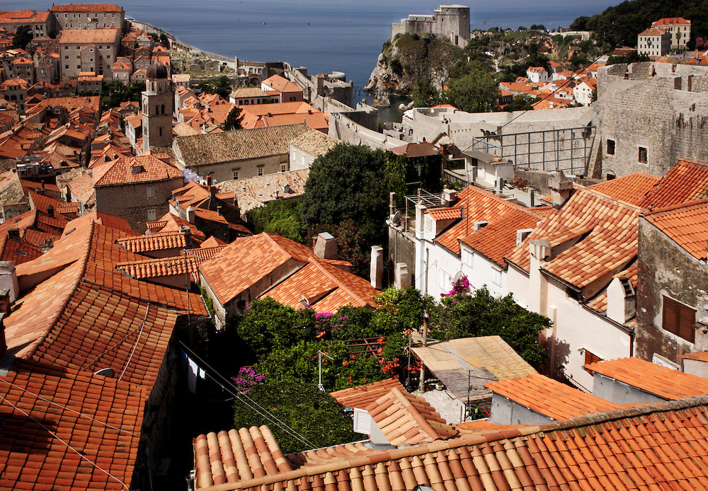 Restored Dubrovnik homes have largely new roofs,made from tiles specially manufactured in Spain by original methods.  Citizens saved many of the original roof tiles, however, and these are used when visible wherever possible, while the new tiles have been set underneath them.  This view taken from the top of the city walls.