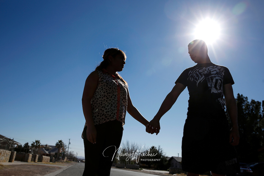Thalia Hernandez and her boyfriend, Rafael Muriel, stand on a street Feb. 15 in the El Paso, Texas, neighborhood where they live. Hernandez at the age of 17 had fled her home in Mexico out of fear for her life and came to the U.S. (CNS photo/Nancy Wiechec)