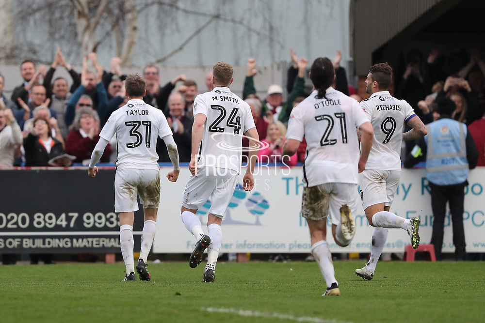Northampton Town midfielder Matthew Taylor (31) scores a goal 0-1 from the penalty spot and celebrates in front of fans during the EFL Sky Bet League 1 match between AFC Wimbledon and Northampton Town at the Cherry Red Records Stadium, Kingston, England on 11 March 2017. Photo by Stuart Butcher.