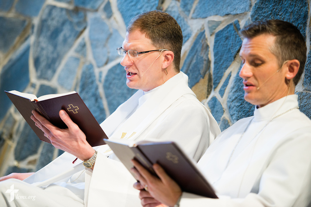 The Rev. Kenton Birtell (center, left), pastor, and Vicar Dan Wiese, sing during worship on Sunday, April 12, 2015, at Mount Calvary Lutheran Church in Holdrege, Neb. LCMS Communications/Erik M. Lunsford