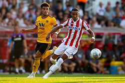 Tom Ince of Stoke City goes past Morgan Gibbs - Mandatory by-line: Robbie Stephenson/JMP - 25/07/2018 - FOOTBALL - Bet365 Stadium - Stoke-on-Trent, England - Stoke City v Wolverhampton Wanderers - Pre-season friendly