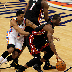 Jun 14, 2012; Oklahoma City, OK, USA;  Miami Heat shooting guard Dwyane Wade (3) drives to the basket as Oklahoma City Thunder shooting guard Thabo Sefolosha (2) trails during the first quarter of game two in the 2012 NBA Finals at Chesapeake Energy Arena. Mandatory Credit: Derick E. Hingle-US PRESSWIRE