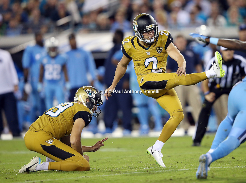 Jacksonville Jaguars punter Bryan Anger (19) holds while Jacksonville Jaguars kicker Jason Myers (2) kicks a 31 yard second quarter field goal that ties the score at 3-3 during the 2015 week 11 regular season NFL football game against the Tennessee Titans on Thursday, Nov. 19, 2015 in Jacksonville, Fla. The Jaguars won the game 19-13. (©Paul Anthony Spinelli)