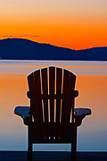Muskoka chairs on Lake of Bays at dusk<br />