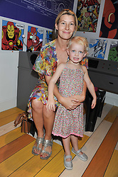 SARA PARKER-BOWLES and her daughter LOLA at a party to celebrate the opening of Purple Dragon - A new family members club at Grosvenor Waterside, 30 Gatliff Road, London SW1 on 29th September 2011.