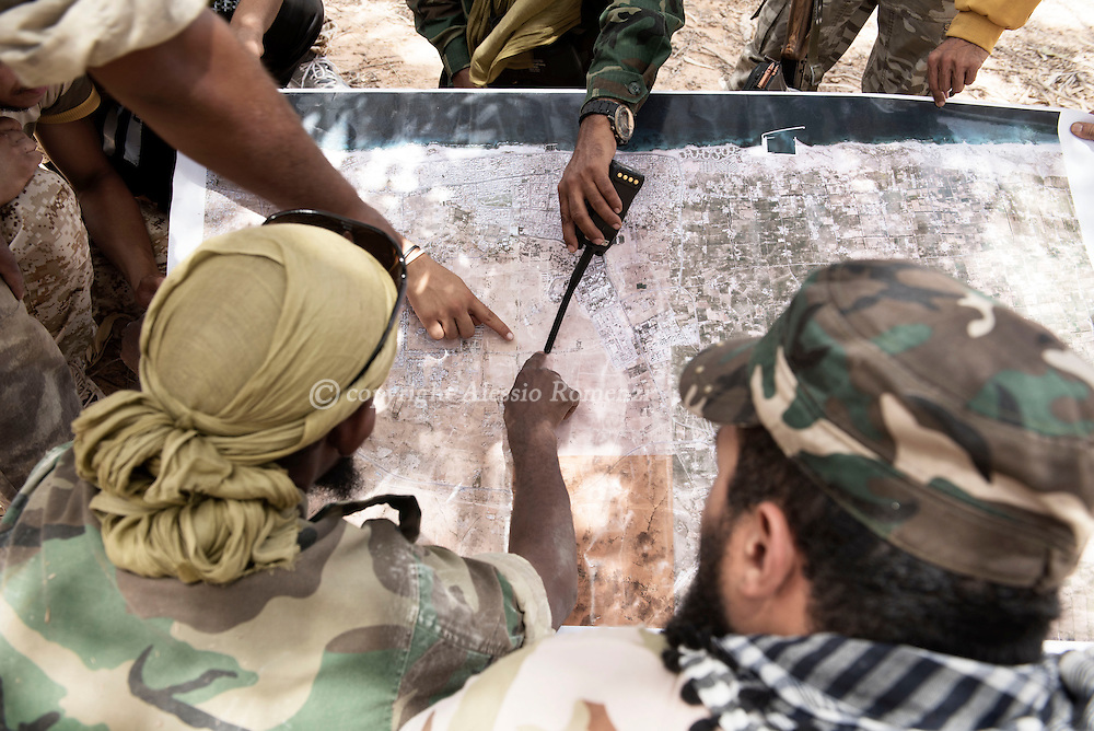 Libya: fighters affiliated with Libya's Government of National Accord's (GNA) study the plan to attack ISIS positions in Ouagadougou center in Sirte. Alessio Romenzi