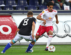 29.09.2011, Stadion Salzburg, Salzburg, AUT, UEFA EL, FC Salzburg (AUT) vs SK Slovan Bratislava (SVK), im Bild Zweikampf zwischen Erik Grendel, (Slovan Bratislava, #8) und Gonzalo Zarate, (Red Bull Salzburg, #11)  // during football match between FC Salzburg (AUT) and SK Slovan Bratislava (SVK) Group Stage (Group F), on September 29th, 2011 at Stadion Salzburg, Austria. EXPA Pictures © 2011, PhotoCredit: EXPA/ T. Haumer